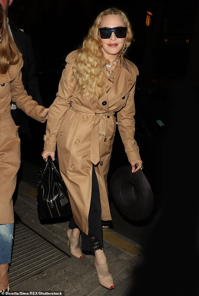 4653274-6224971-Chic_The_Vogue_hitmaker_slipped_into_a_camel_coloured_double_bre-m-3_1538338601671